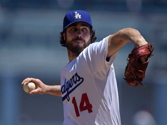 Los Angeles Dodgers starting pitcher Dan Haren throws to the plate against the Milwaukee Brewers on Sunday in Los Angeles.