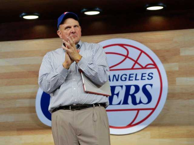 New Los Angeles Clippers owner Steve Ballmer applauds after speaking at the Clippers Fan Festival on Monday, Aug. 18, 2014, in Los Angeles. (AP Photo/Jae C. Hong)