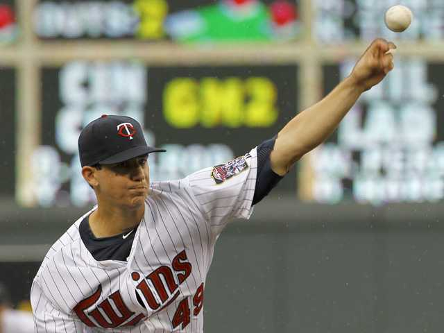 Minnesota Twins starting pitcher and Saugus graduate Tommy Milone delivers to the Kansas City Royals in Minneapolis on Sunday.