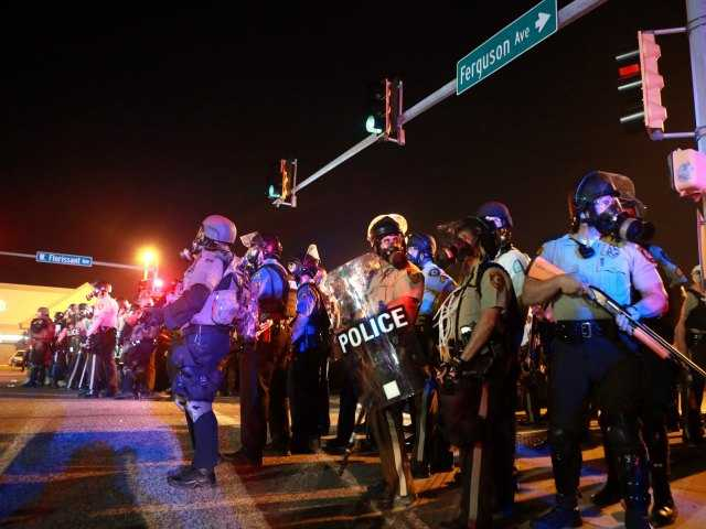 Police, protesters collide again in Ferguson