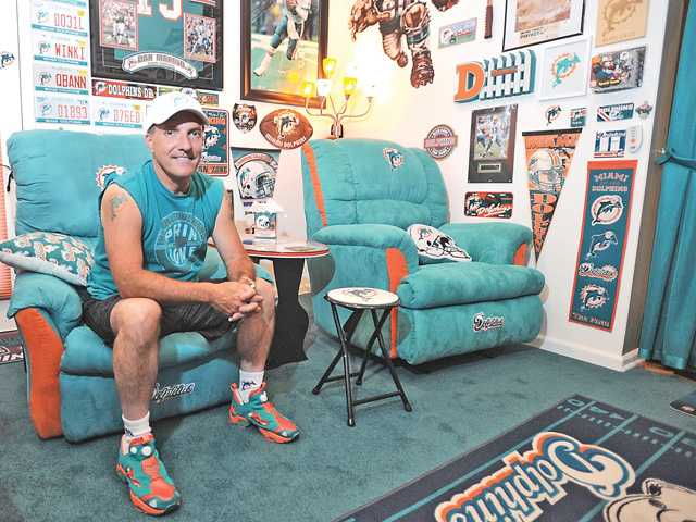 "Stuart Thompson has spent years gathering memoribilia for his Miami Dolphins ""man cave"". Signal photo by Katharine Lotze"