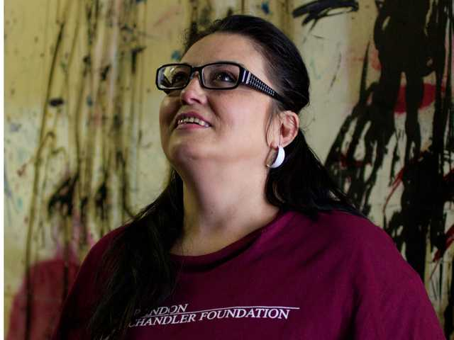 Former inmate and client of the Brandon Chandler Foundation Desiree Gonzales tours The Signal's warehouse. Austin Dave / The Signal