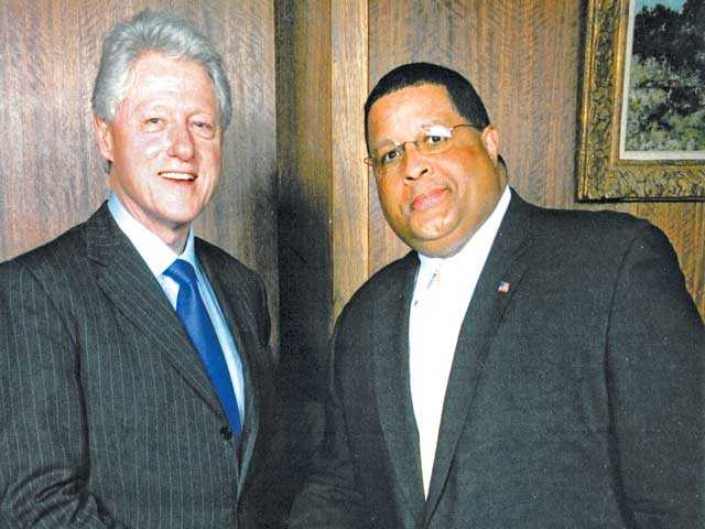 Louis Perry stands with former President Bill Clinton. Louis Perry/Courtesy photo