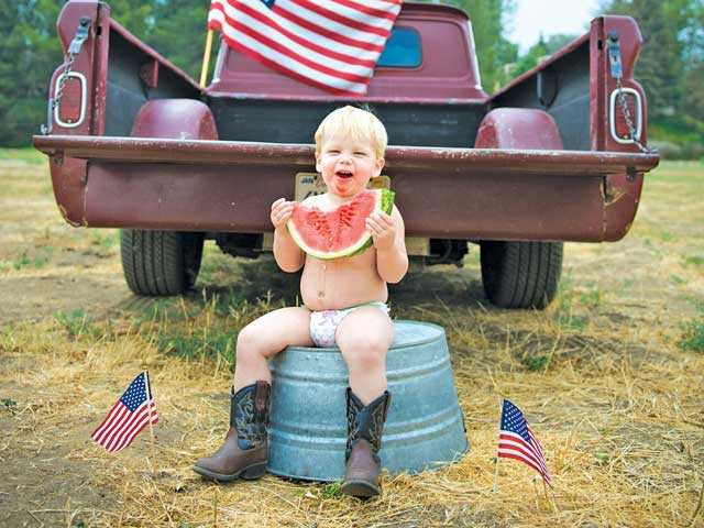Castaic tyke Cash, named for famed singer Johnny Cash, enjoys his watermelon, music and American-themed photo shoots. Brendie Heter/Courtesy photo