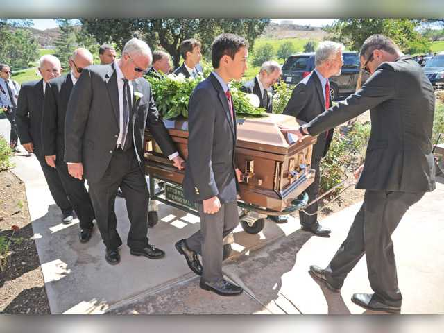 The casket of Connie Worden-Roberts is moved from the memorial service in the Zane Grey Garden at Eternal Valley Memorial Park & Mortuary in Newhall on Saturday. Signal photo by Dan Watson