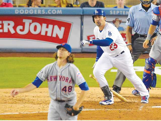Los Angeles Dodger Adrian Gonzalez, right, and New York Mets starting pitcher Jacob deGrom watch Gonzalez's three-run home run on Saturday in Los Angeles.