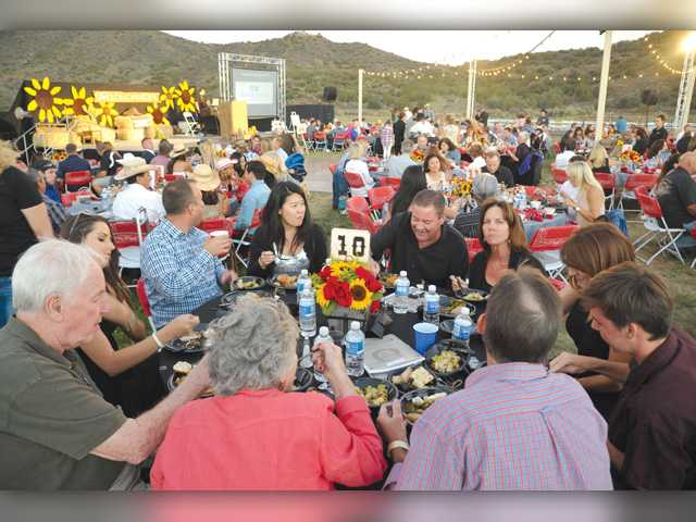 Hundreds of attendees sit down for dinner at the 18th Annual Heart of the West fundraiser for Carousel Ranch held at the Agua Dulce Airpark in Agua Dulce on Saturday. Signal photo by Dan Watson.