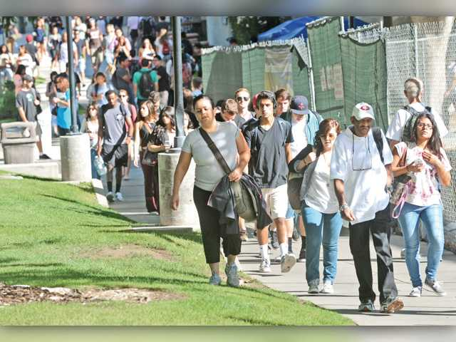 Students head to class between the Honor Grove and a construction site on the College of the Canyons Valencia campus Monday, the first day of classes for the fall semester. Signal photo by Dan Watson