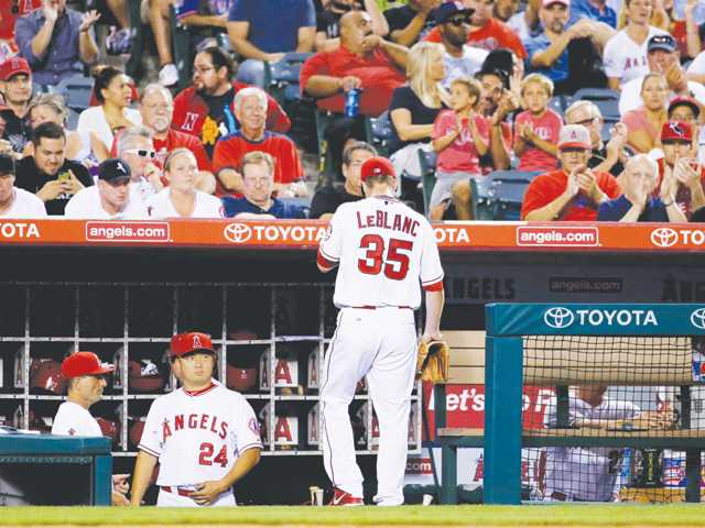 Los Angeles Angels starting pitcher Wade LeBlanc leaves the game against the Miami Marlins in Anaheim on Monday.