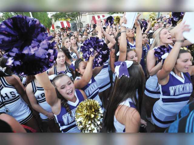 The Valencia High School cheer team cheers on their football players as they compete in the fifth annual Santa Clarita Valley Burrito Bowl. Signal photo by Dan Watson.