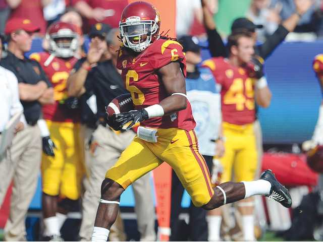 In this Oct. 2013 file photo, USC safety Josh Shaw recovers a Utah fumble.