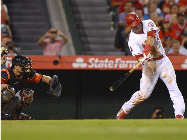 Los Angeles' Mike Trout connects for a solo home run in Wednesday's game in Anaheim.