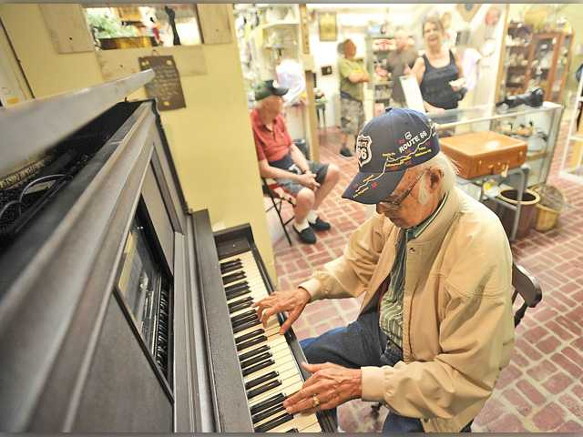 Palmdale resident Bill Swain plays at the Country Antique Fair Mall in Santa Clarita every other Tuesday from about noon until 2 p.m. Signal photo by Katharine Lotze.