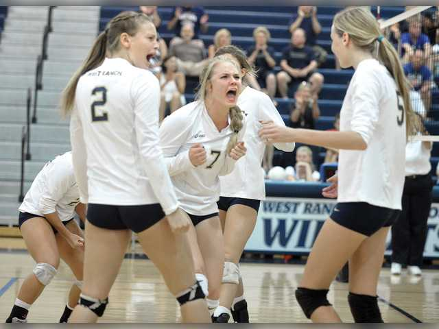 West Ranch players Katie Jacobs (2), Cassidy Peters and Annika Bergstrom celebrate on Tuesday at West Ranch High School. Signal photo by Dan Watson