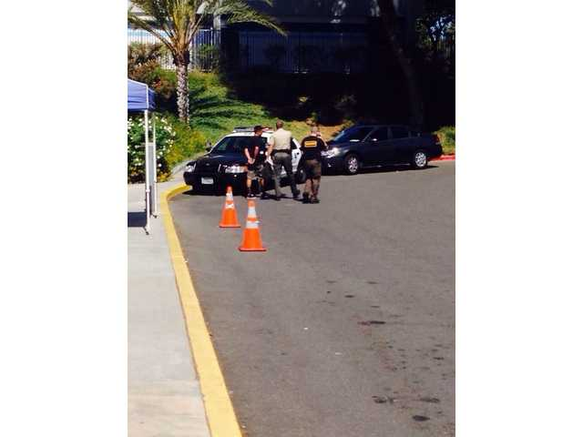 One Saugus High School student could be seen handcuffed in a photograph circulated Thursday on social media.