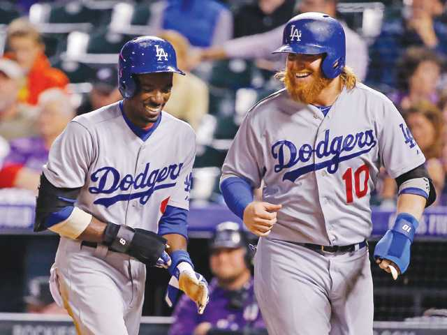 Dodgers ride 8-run inning to win