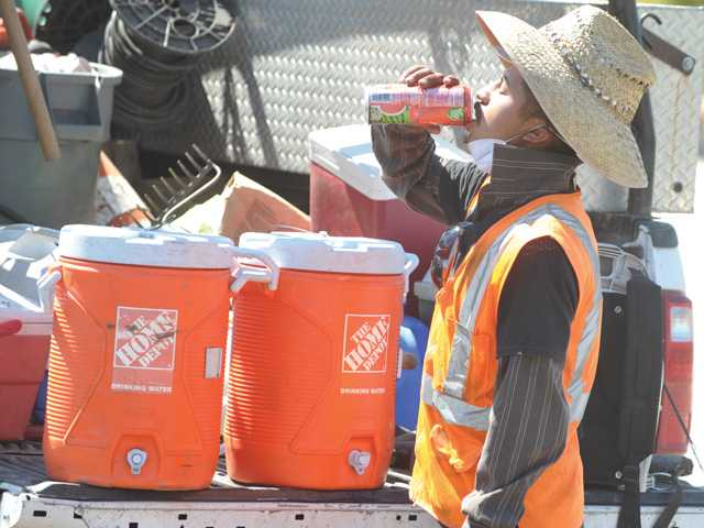 SCV workers try to beat the heat