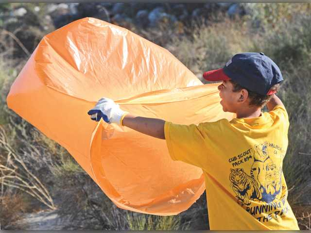 No water, but volunteers make a splash at river cleanup day