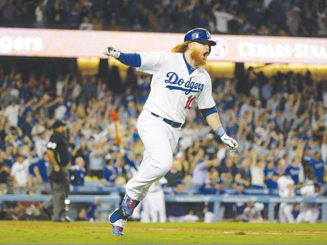 Dodgers top Giants to stretch NL West lead