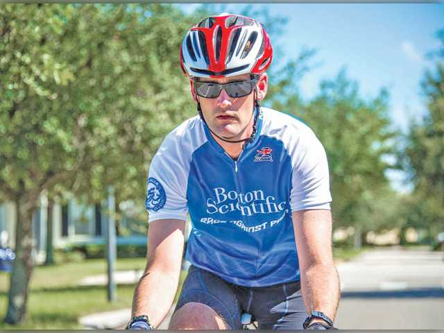 Justin Minyard and his ability to participate in events like the Gran Fondo Italia as a result of spinal cord stimulation. The device is made by Boston Scientific in Valencia.
