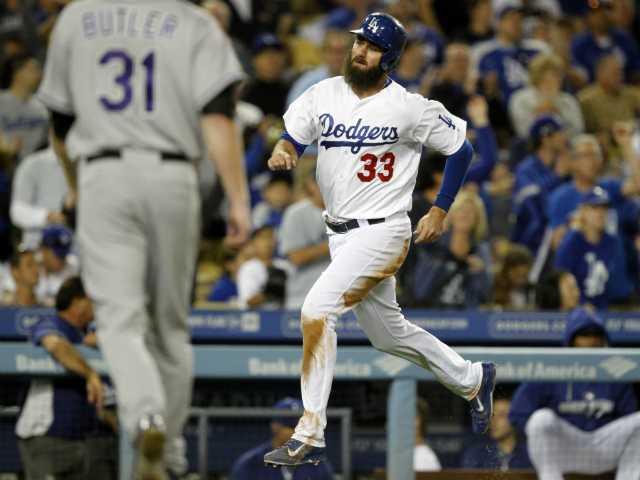 Dodgers top Rockies in 12th