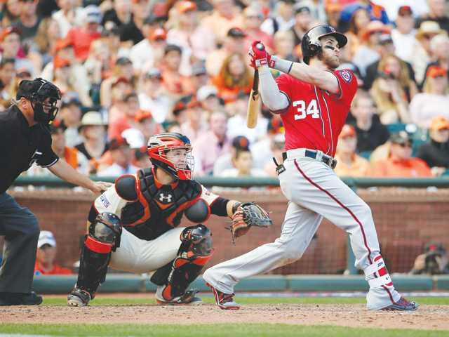 Nationals stay alive with win over Giants