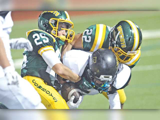 Canyon football puts away feisty GV