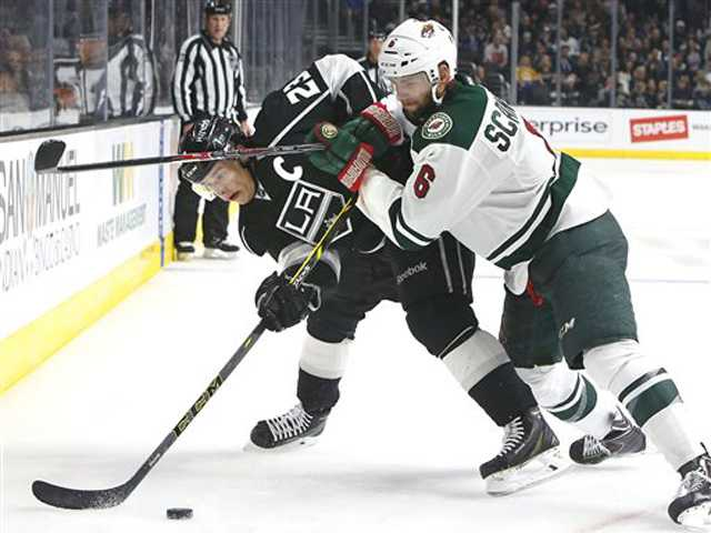 Kings hold off Wild for fourth straight win