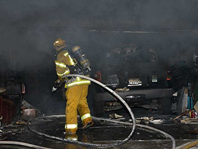 UPDATE: Neighbors rescue woman from burning Canyon Country home