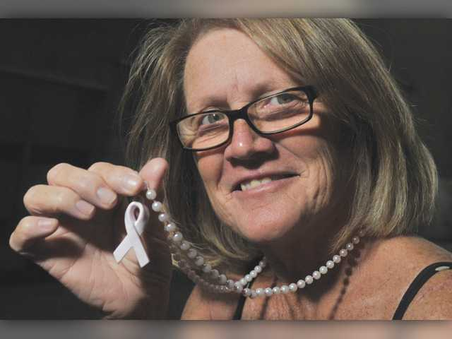 Strength: Breast cancer survivor fights to thrive