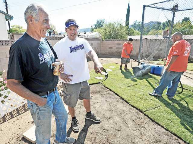 Veteran, volunteer surprised with yard makeover