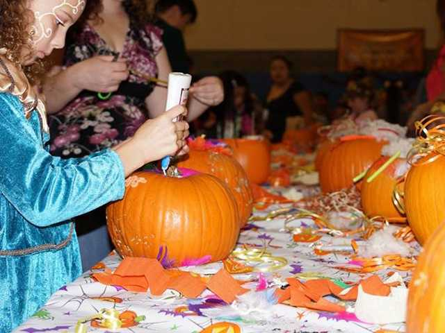 Rotary Club partners with community center for Halloween Fiesta
