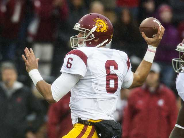 USC quarterback Cody Kessler (6) attempts a pass against Washington State on Saturday at Martin Stadium in Pullman, Wash.