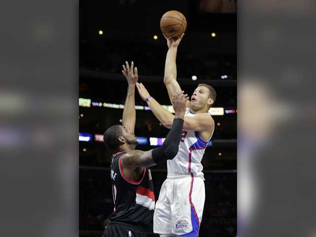 Clippers hang on to beat Trail Blazers 106-102