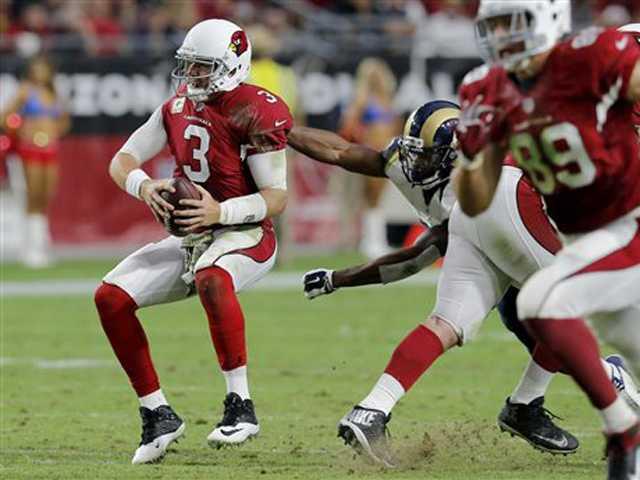 Palmer hurt, Stanton rallies Cardinals past Rams