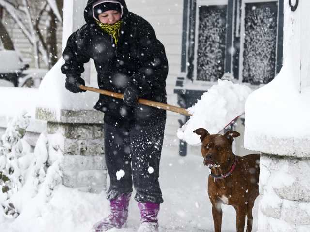 Early winter pummels much of country, strands cars