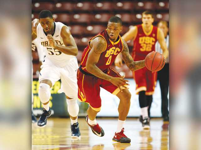 USC's Darion Clark, center, brings the ball upcourt against Drexel's Tyshawn Myles, left, during the Charleston Classic tournament in Charleston, S.C., on Friday.