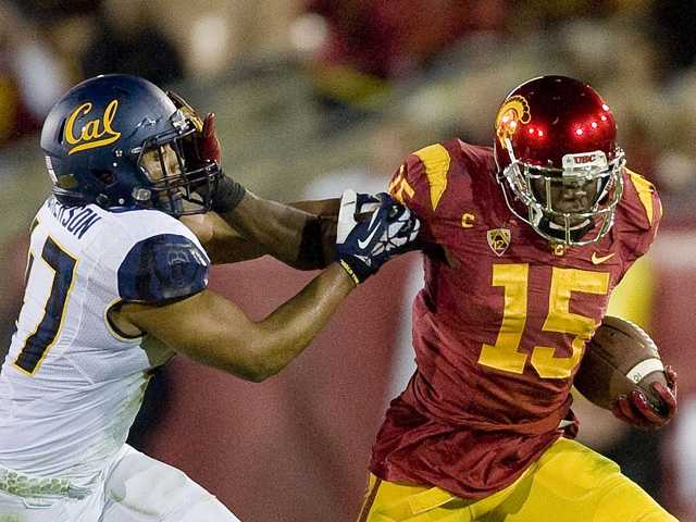 USC wide receiver Nelson Agholor, right, pushes Cal linebacker Hardy Nickerson away on Nov. 14 in Los Angeles.