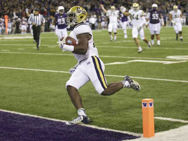 UCLA running back Myles Jack scores a touchdown against Washington on Nov. 8 in Seattle.