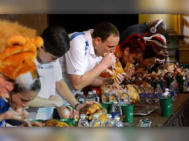 Joey Chestnut devours turkey to win eating contest