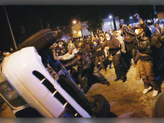 Another night of unrest in Ferguson, several US cities