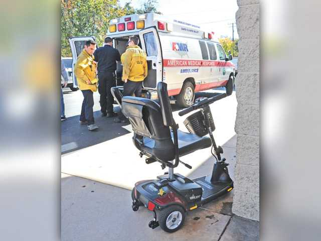 Woman injured in Newhall parking lot collision