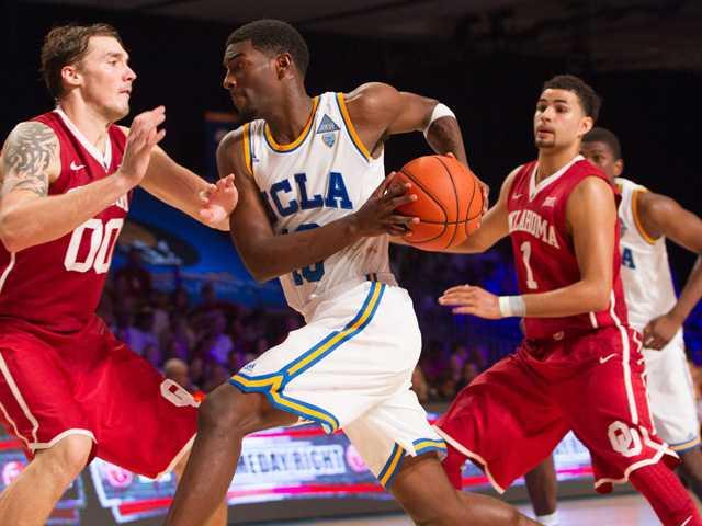 UCLA's Isaac Hamilton (10) drives into Oklahoma's Ryan Spangler (00) as Oklahoma's Frank Booker (1) looks on during their game in the Battle 4 Atlantis basketball tournament in Paradise Island, Bahamas on Wednesday.