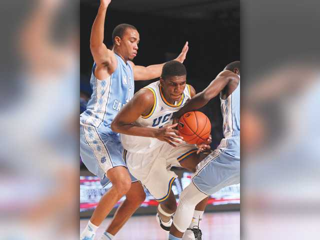 UCLA's Kevon Looney (5) gets caught between North Carolina defenders Brice Johnson (11) and Theo Pinson (1) in Paradise Island, Bahamas on Thursday.
