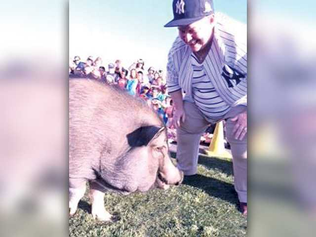 Principal kisses pig at  Plum Canyon