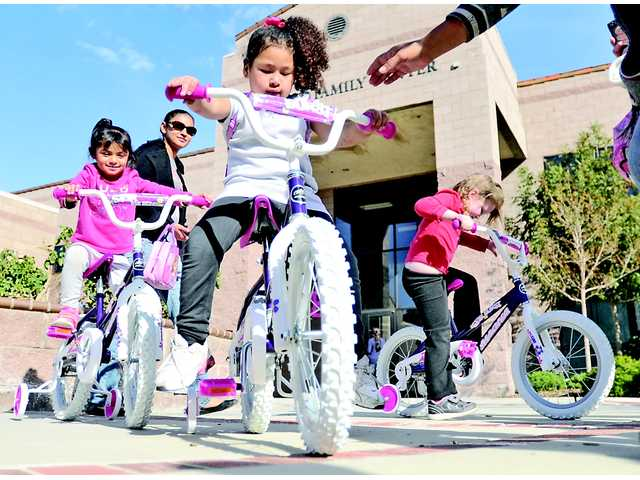 Chiquita Canyon Santa's Helpers deliver bikes to kids