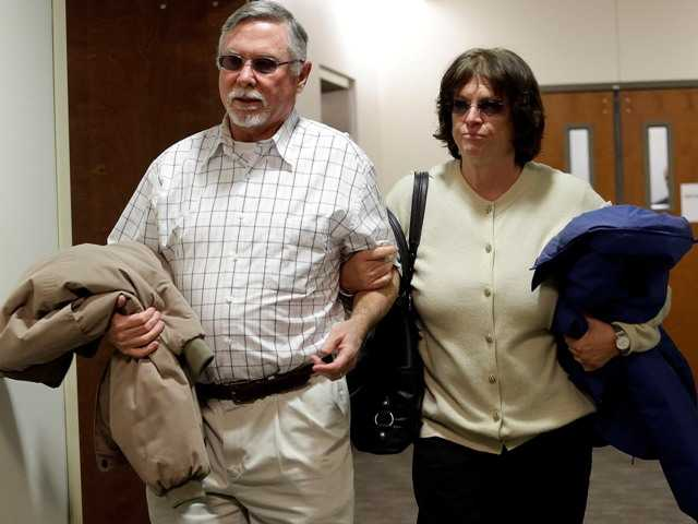 Theater shooter's parents plead for his life