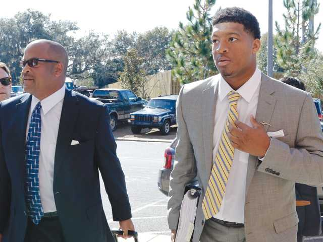 Florida State quarterback Jameis Winston, right, and his attorney David Cornwell arrive at Florida State's Materials Research building for his student code on conduct hearing on Dec. 2 in Tallahassee, Fla.