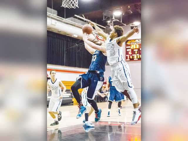 West Ranch basketball pushed to brink in win over Trinity