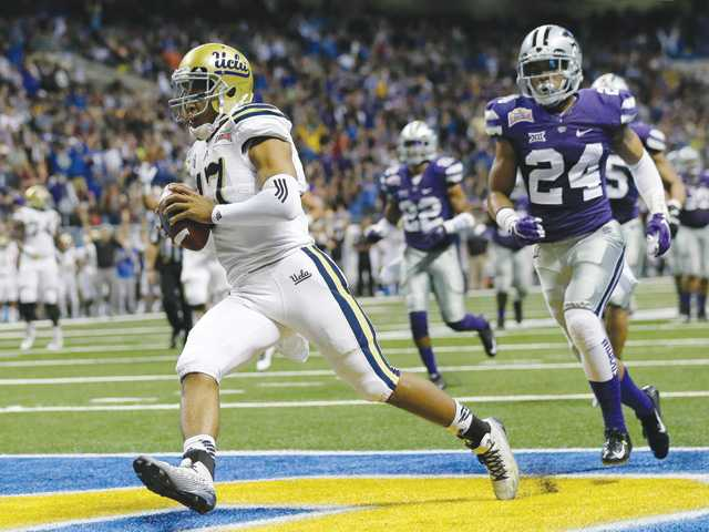 UCLA's Brett Hundley (17) rushes for a touchdown against Kansas State during the Alamo Bowl on Friday in San Antonio.